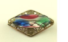 Gemstone brooch coloured