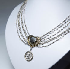 Elegant antique necklace with filigree design and blue stone