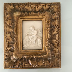 Special wall decoration 3D - Cupid on sleeping lion in gold-coloured flaming frame