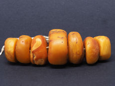 7 Antique natural amber beads. West African trade