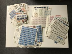 500 partial sheets, well over 10,000 individual stamps
