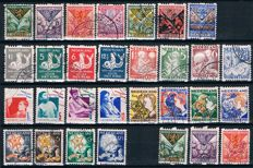The Netherlands 1925/1933 - Batch syncopated perforation child stamps