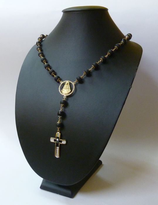 18 k gold rosary with rubber beads