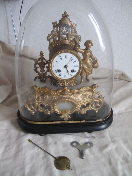 French pendulum clock in zamak regulus under a dome - Napoleon III period