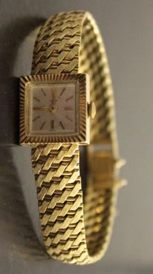 Tudor gold wristwatch with Rolex crown