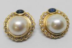 Earrings - 18 kt Yellow Gold - Japanese Pearls surrounded by 36  Diamonds and two Sapphires