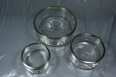 Set of three bowls, cut crystal with silver edging, France, circa 1915