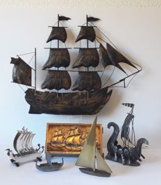 Collection of decorative sailing boats, including Viking ships and a brass boat in Art Deco style