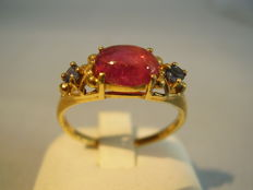 Antique gold ring with red tourmaline (1.25 ct) and blue sapphires (0.18 ct)