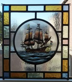 Beautiful stained glass suncatcher with the image of a Dutch East India Company (VOC in Dutch) ship, restored