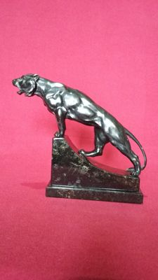 Bronze lion on a African black marble base