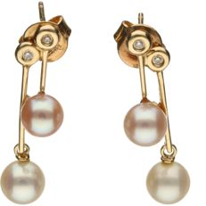 14 kt yellow gold dangle earrings with cultured pearls set with brilliant cut diamonds of approx. 0.02 ct in total - length x width: 2 x 0.6 cm