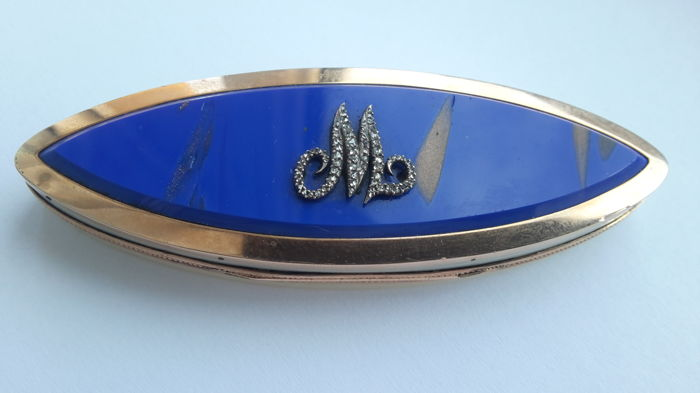 An almond shaped gold mounted, lapis lazuli coloured stone and ivory snuff box - probably England - late 19th century