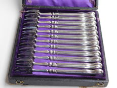 Twelve silver oyster forks in box, France, ca 1880