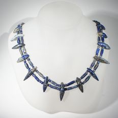 Lapis Lazuli necklace with two rows of small beads interspaced by double perforated navette shaped spacer beads. L 45 cm