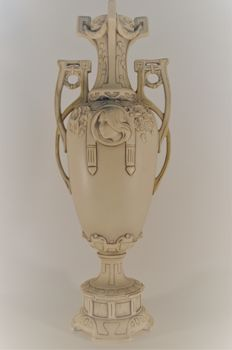 Royal Dux - Art Nouveau two handled vase decorated with a female face