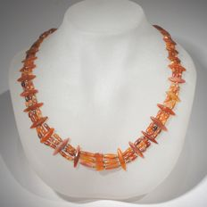 Spectacular necklace with three rows of carnelian and beads. Bactrian.  53cm