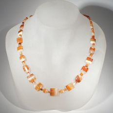 A very rare necklace of pillow shaped and barrel shaped banded agate beads.  L 52 cm