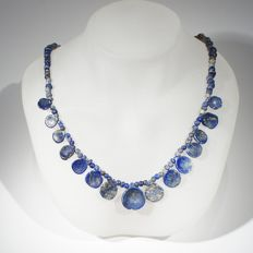 Lapis lazuli necklace of round beads interspaced with beads in the shape of a bowl.   l 45 cm
