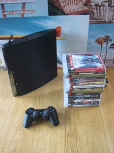 PS3 console (160gb) + 15 original games like: GTA V + Assassins creed rogue + Call of duty and more