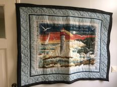 Quilt with lighthouse in the lead role