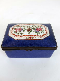 A metal mounted porcelain pill box