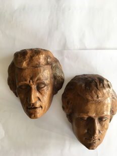Walnut wood sculptures representing the portrait of Wolfgang Amadeus Mozart from the middle of 20th century (Switzerland)