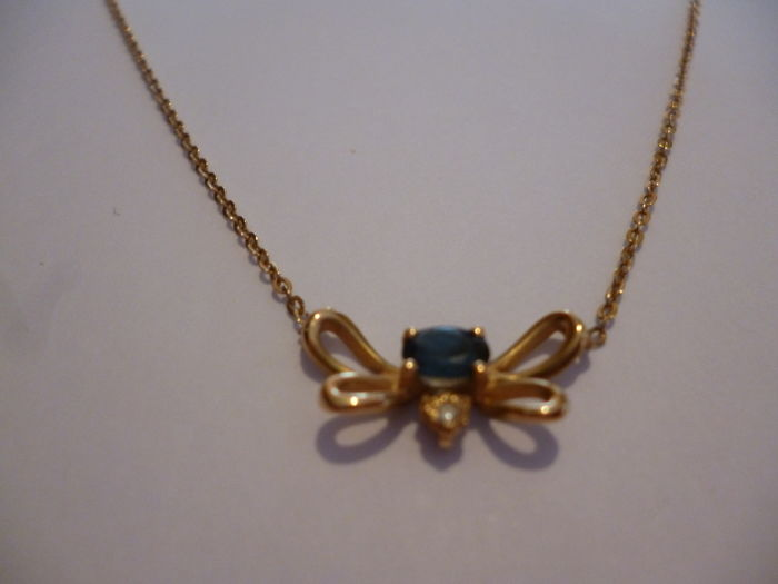 Superb necklace with a sapphire of approx. 0.40 ct, 18 kt gold + diamond