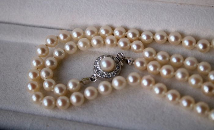 Necklace with round Japanese Akoya sea salty very shiny pearls with very good luster and wonderful silver lock with Strass stones.