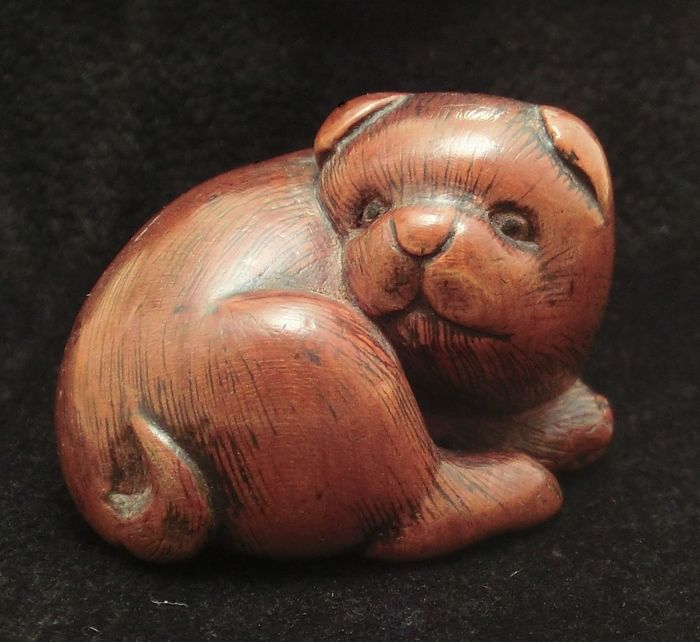 A genuine antique wood Netsuke of a Puppy, signed BUNPO - Japan - 19th century