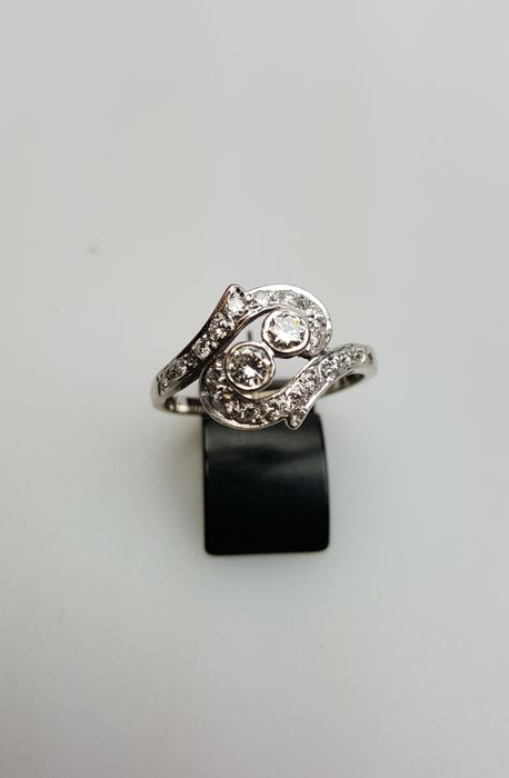 White gold fantasy ring with diamond