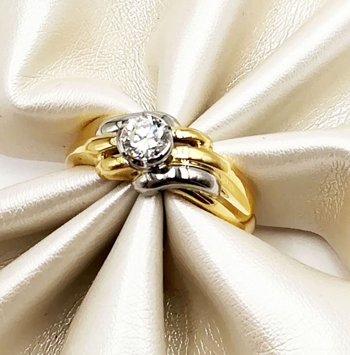 Women's ring in 18 kt yellow and white gold with brilliant cut diamond, colour G VS, total 0.35 ct, size 14.50, total weight 5.76 g