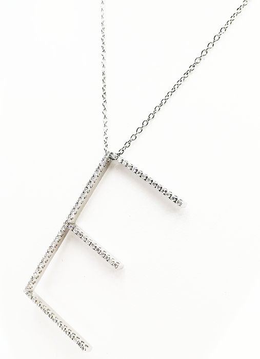 "Chain in white gold 18 kt women's with initial letter ""E"" in brilliant cut diamonds COLOUR G VS TOTAL 0.34 CT Length of chain 50.00 cm, length  of pendant length 4.00 cm"