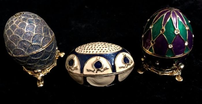 A collection  of three beautiful  CHRISTMAS  -  enamelled - eggs -with  jewelled  colorful decoration