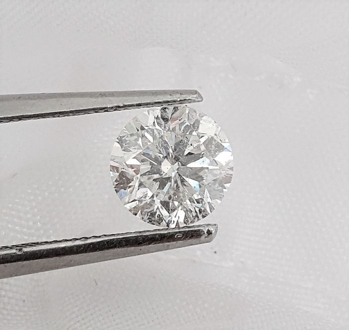 Diamond of  1.02 carat , F color , SI1 clarity , Big IGL certificate + Laser Inscription on Girdle , Cut= EX .