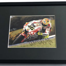 Framed photo,  authentic and personally hand signed by Valentino Rossi