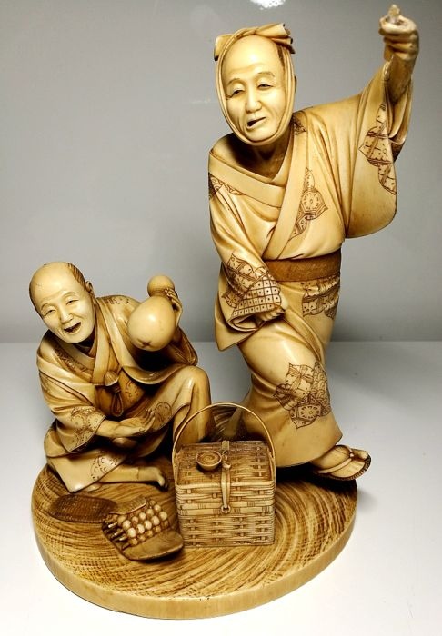 Large, Japanese, ivory Okimomo - Two men at a feast - Japan - late 19th century / early 20th century (Meiji period) *Low Reserve Price*