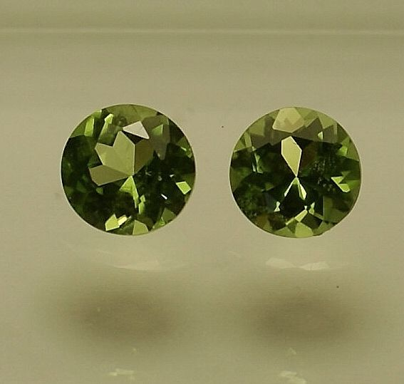 2 Peridots  (pair) - total 3.01 ct   NO RESERVE