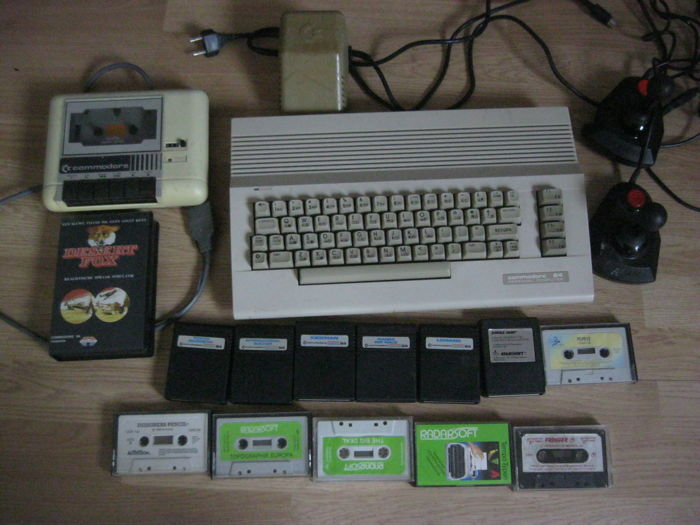Commodore 64 with tape recorder 2 joy sticks and 6 Rom