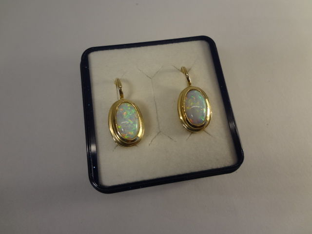Pair of 8 ct opal, gold earrings, oval, 14 kt / 585, emerald, ruby, sapphire, gold earrings