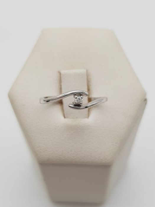 18 kt gold solitaire ring, branded Comete, with 1 brilliant cut diamond, approx. 0.03 ct, colour F-G, VVS - ring size 9/10 (IT)