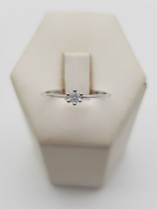 18 kt gold solitaire ring with 1 brilliant cut diamond, approx. 0.09 ct, colour F-G, VVS - ring size 12 (IT)