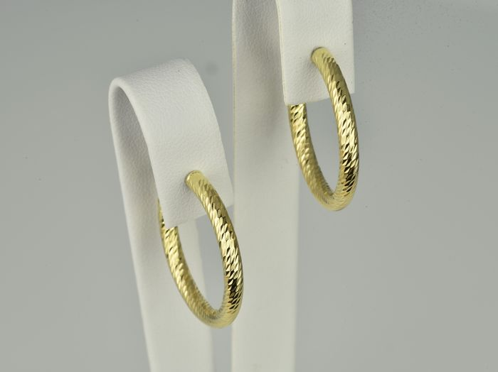 Creole earrings in gold of 18 kt  Diameter: 27 mm