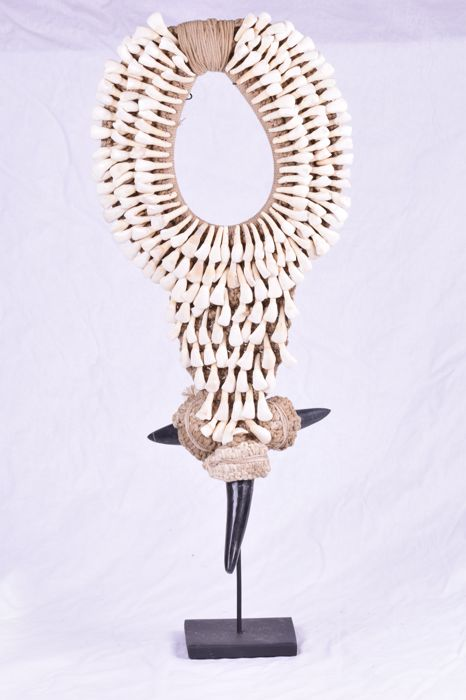 Decorative necklace on stand, cow teeth/horns in Papua style - Indonesia