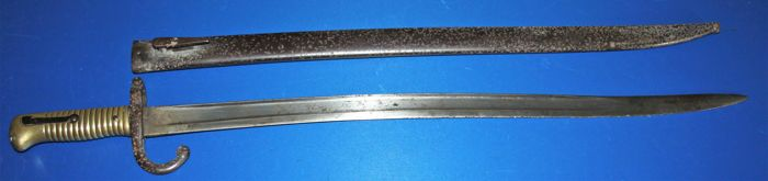 French model bayonet for Chassepot in fair condition, Maker: Arsenal Tulle, German regimental markings on the crossguard dated 1867, in fair condition