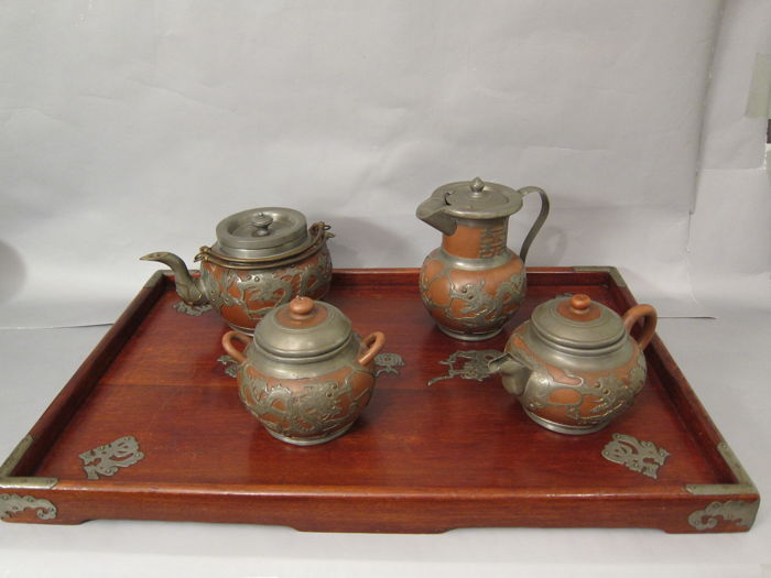 A Chinese wood and pewter tray, a terracotta and pewter coffee pot, a terracotta and pewter bowl and two teapots - China - first half 20th century
