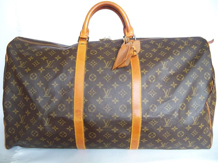 30bbfd9d35d Louis Vuitton - Keepall 60 Luggage bag + LV Accessories -*No Reserve  Price!* - Vintage - Catawiki