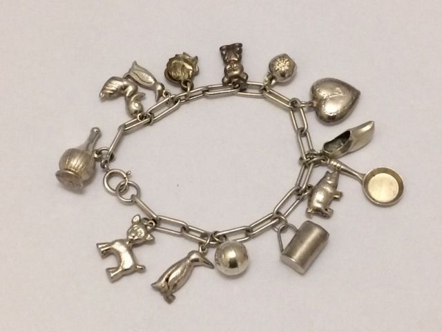 835 Silver Charm bracelet with 14 charms - length: 19 cm