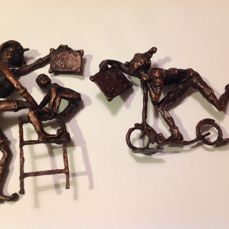 Bronze statuettes on the way to school. - 2