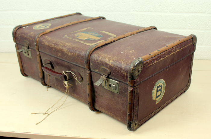 An antique travel case - wood and leather